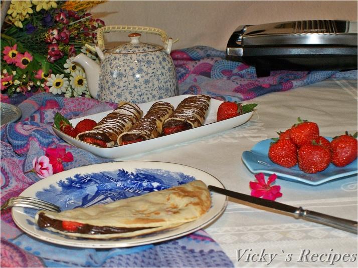 Clătite cu cremă de ciocolată și căpșuni